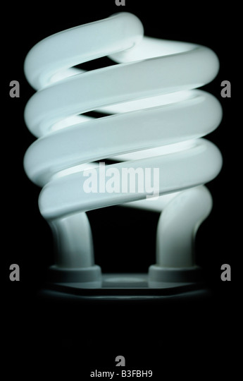 Energy Saving Compact Fluorescent Lightbulb Close Up an Environmentally Friendly Alternative to Traditional Light - Stock Image