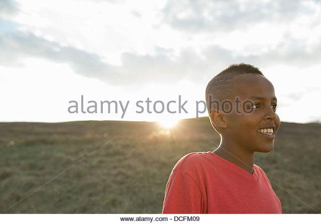 Smiling schoolboy looking away - Stock Image