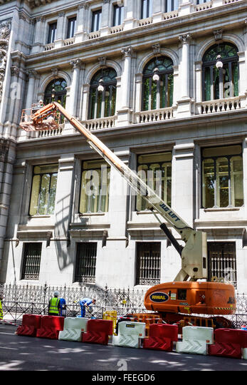 Madrid Spain Europe Spanish Hispanic Centro Retiro Paseo del Prado construction work Riwal aerial work platform - Stock Image