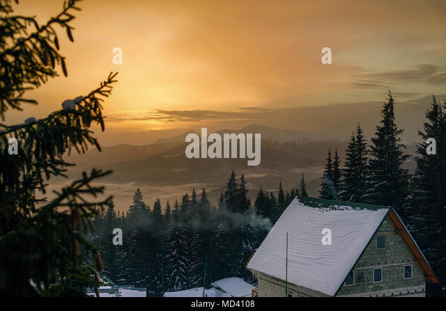 Elevated view of snow capped mountains at sunset, Gurne, Ukraine, Eastern Europe - Stock Image