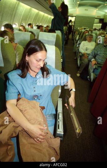 Russia former Soviet Union Frankfurt to St. Petersburg onboard Aeroflot airliner passenger broken arm rest - Stock Image