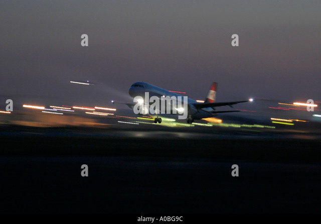 Airliner taking off at night - Stock Image