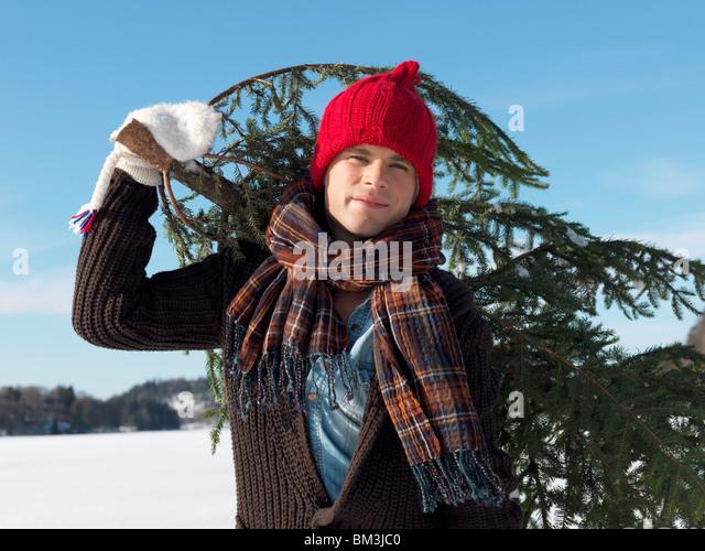 Man with christmas tree - Stock Image