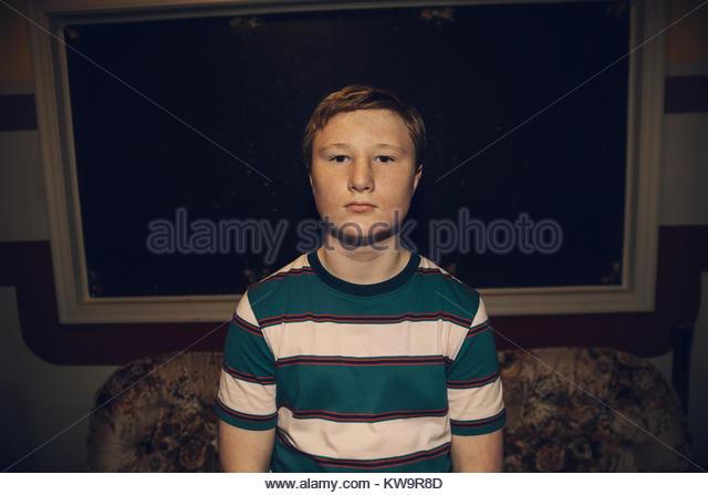 Portrait serious,confident Caucasian tween boy - Stock Image