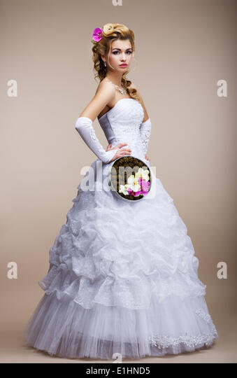 Wedding. Newlywed in White Dress holding Special Bouquet of Flowers - Stock Image