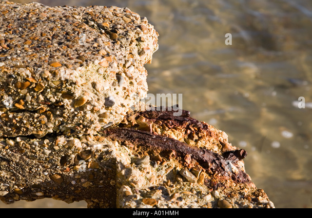 exposed rusty steel in corroded reinforced concrete - Stock Image