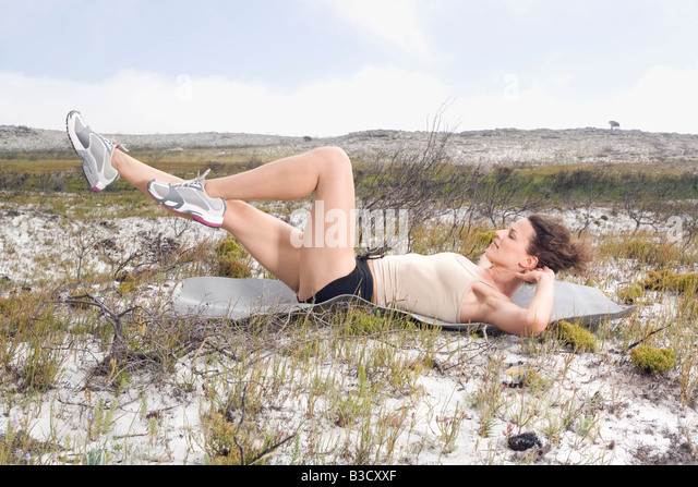 South Africa, Cape Town, Young woman doing yoga - Stock Image