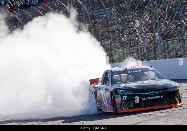 Ridgeway, Virginia, USA. 29th Mar, 2015. Denny Hamlin (11) celebrates his win of the STP 500 at Martinsville Speedway - Stock-Bilder