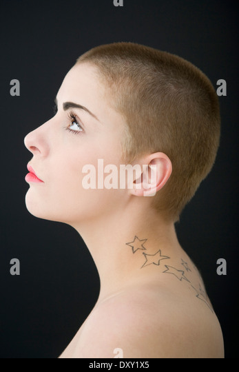Portrait of a young woman with a shaved head. - Stock-Bilder