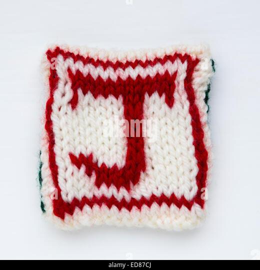 letter J Knitted woollen lettering. - Stock Image