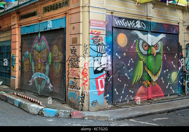 Istanbul, Turkey - April 18, 2017:  Closed shop exteriors with metal rolling doors painted with colorful graffiti - Stock Image