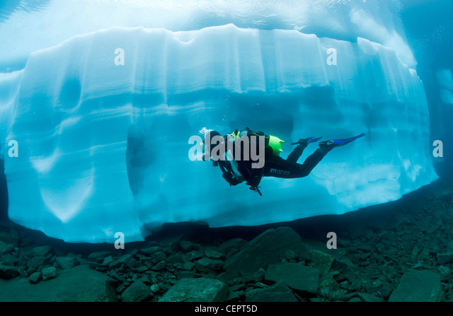Ice Diving in Mountain Lake Sassolo, Sambuco Valley, Ticino, Switzerland - Stock Image