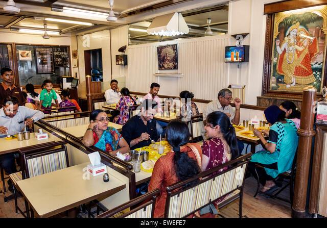 Mumbai India Indian Asian Tardeo Jehangir Boman Behram Road Hindmata restaurant inside interior tables customers - Stock Image