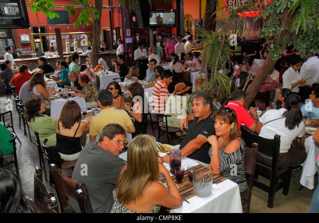 Lima Peru Barranco District Parque Municipal Restaurante Rustica restaurant business crowded popular tables dining - Stock Image