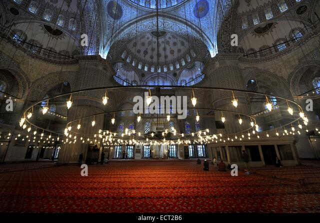 Prayer room with red carpet, Sultan Ahmed Mosque, Sultanahmet, Istanbul, Turkey - Stock Image