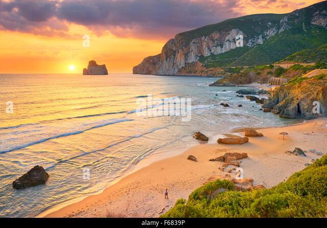 Pan di Zucchero at sunset time, Masua Village Beach, Sardinia Island, Italy - Stock Image