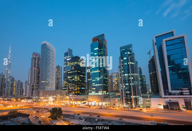 Skyline of new office towers at night  in Business Bay district of Dubai United Arab Emirates - Stock-Bilder