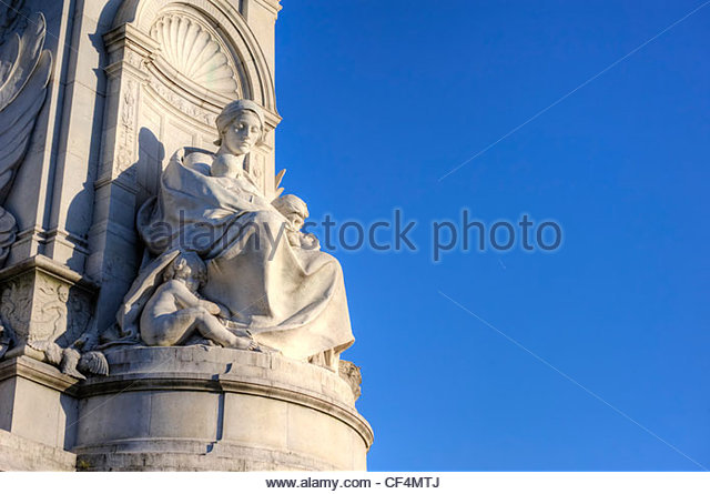 A sculpture representing motherhood on the Victoria Memorial in Queen's Gardens outside Buckingham Palace. - Stock Image
