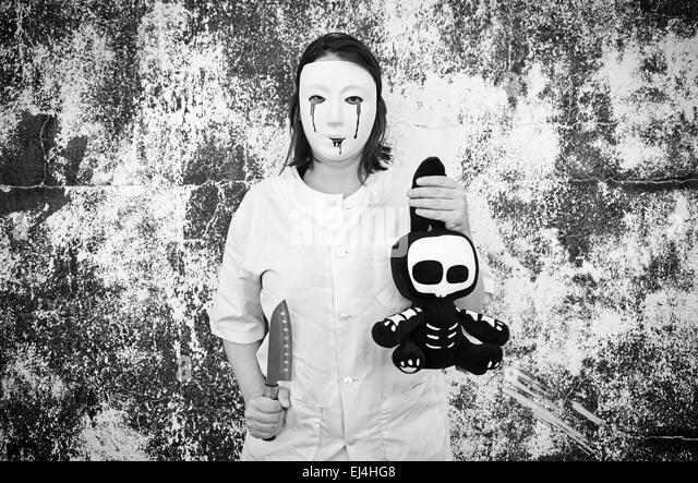Violent woman with bloody mask, halloween - Stock Image