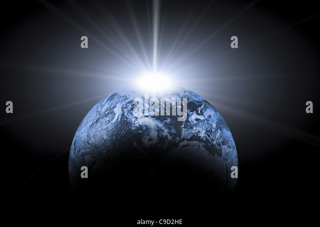 Light glowing behind the Earth - Stock Image