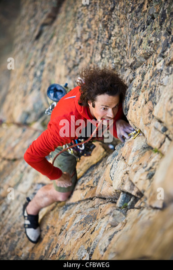A man rock climbing, Assholes of August 5.9, Skaha Bluffs, Skaha, Penticton Area, British Columbia, Canada - Stock Image