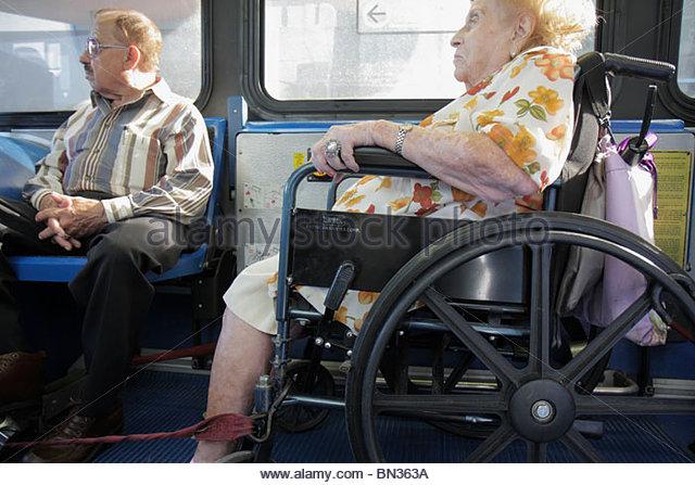 Miami Florida Metrobus mass transit public transportation passenger wheelchair ADA accessibility woman man senior - Stock Image