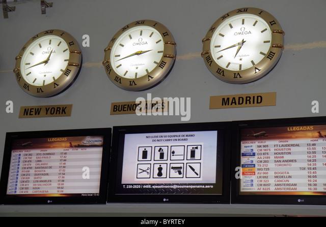 Panama City Panama Aeropuerto Tocumen airport PTY aviation terminal concourse Omega clock time zone Madrid New York - Stock Image