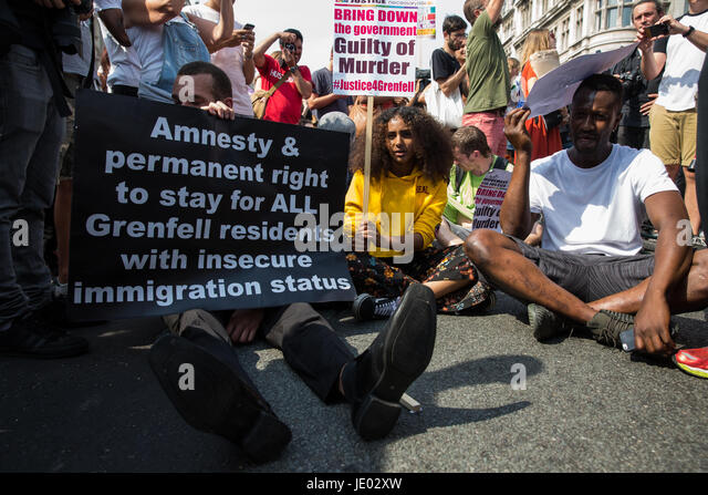 London, UK. 21st June, 2017. Activists from Movement For Justice By Any Means Necessary sit down in the road in - Stock Image