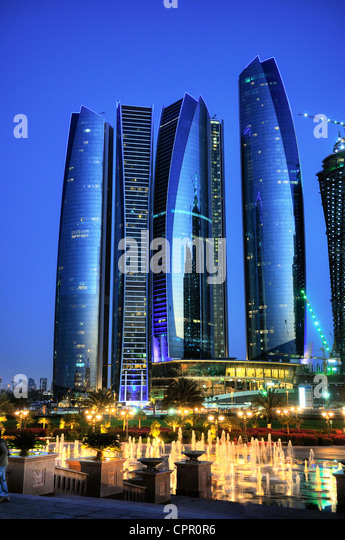 Skyscrapers in Abu Dhabi at dusk, United Arab Emirates - Stock Image