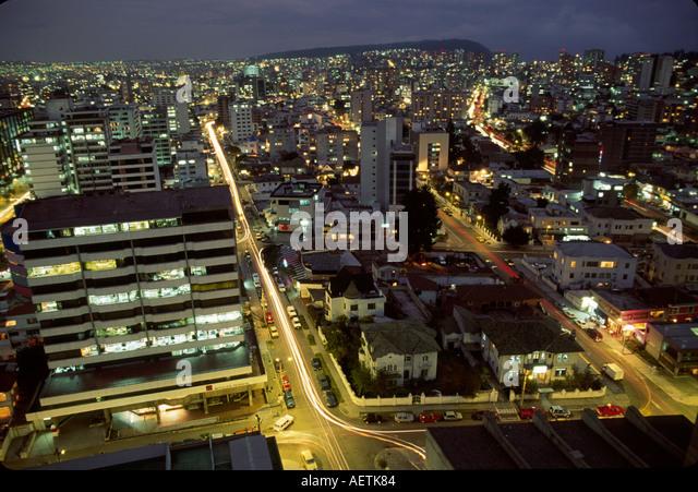 Ecuador Quito aerial city skyline office building traffic lights dusk - Stock Image