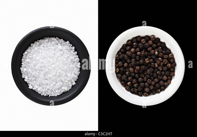 Rock Salt and black Peppercorns - Stock Image