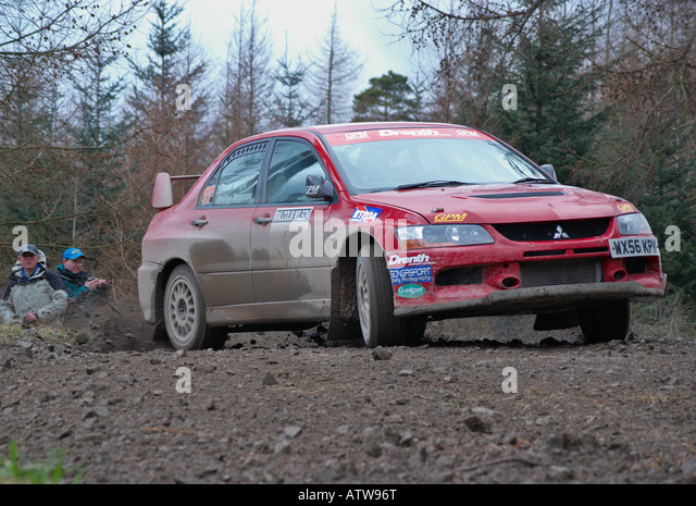 Rally Car on a special forest stage of a motor sport rally - Stock Image