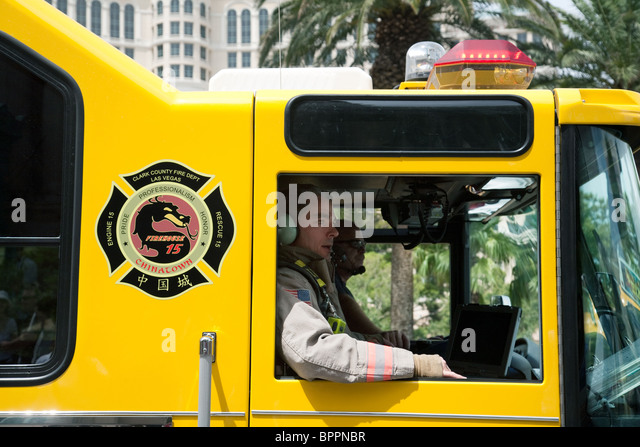 Firemen in a Clark County firetruck on the strip, Las Vegas Nevada USA - Stock Image