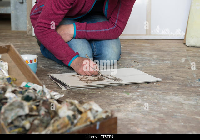 Female artist making sketch in art studio, Bavaria, Germany - Stock Image