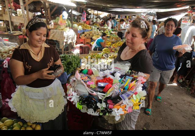 Managua Nicaragua Mercado Roberto Huembes market shopping marketplace vendor stall produce Hispanic woman worker - Stock Image