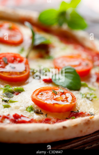 fresh italian pizza, with tomato, mozzarella and green pepper - Stock Image
