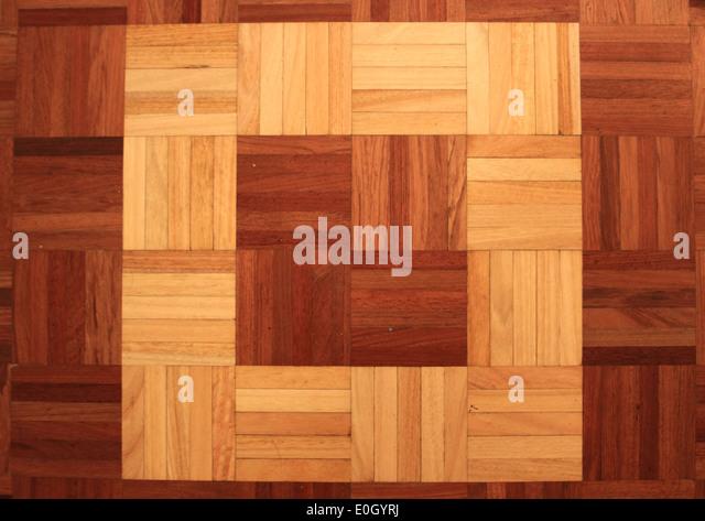 Teakwood floor of quadratic sticks forming a quadrant - Stock-Bilder