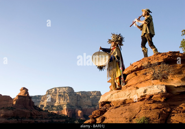 Havasupai Medicine Man with drum and Spiritual Healer with flute - Trail off Dry Creek Road, Sedona Arizona - Stock Image