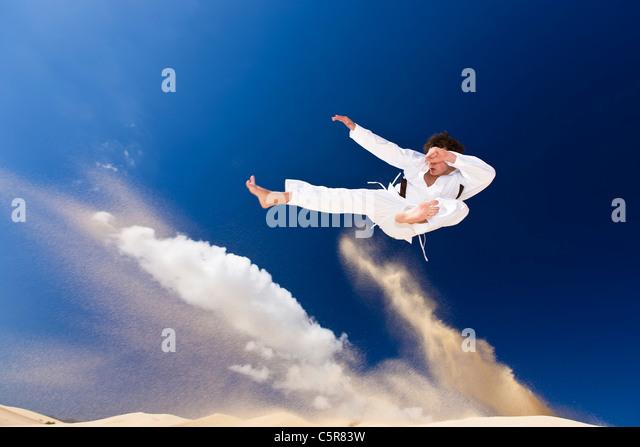 Martial artist in full flight. - Stock-Bilder