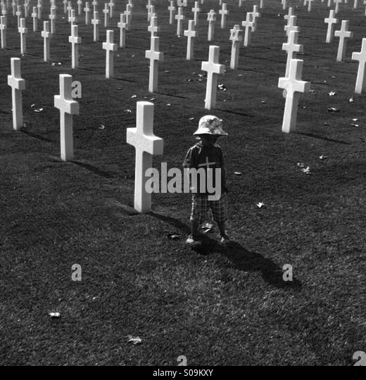 Child at military cemetery - Stock Image