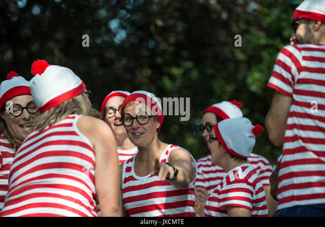 A group of charity event participants dressed as the character in the Martin Handford illustrated books of Where's - Stock Image