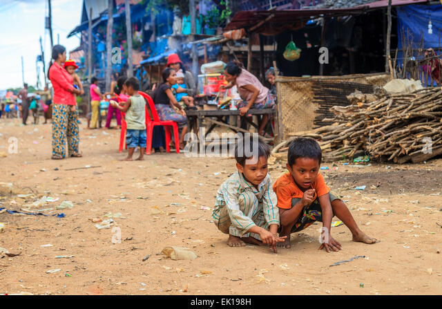 Children playing  in the middle of the street at Kampong Phulk floating village - Stock-Bilder
