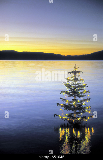 Christmas tree in calm water decorated with lights Lake Tahoe California USA - Stock Image