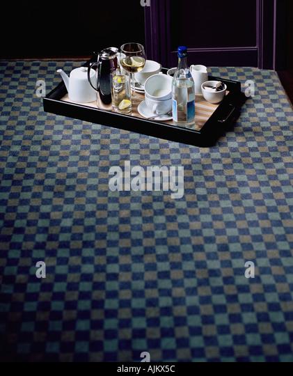 Tray on hotel carpet - Stock-Bilder