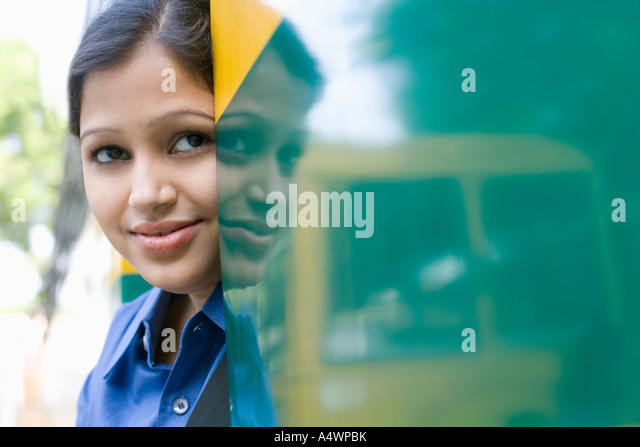 Female student standing in school bus door - Stock-Bilder