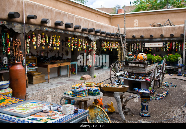 outdoor market in Santa Fe New Mexico selling Colorful tiles, plates, art pieces and pottery - Stock Image