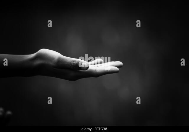 Human Hand Against Black Background - Stock-Bilder