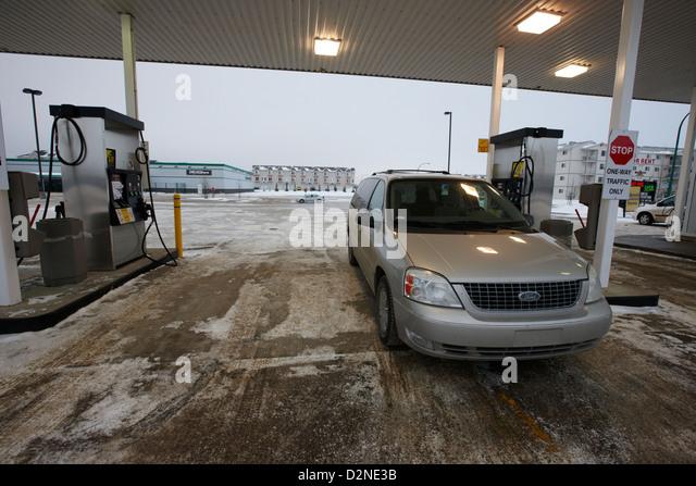 mpv at gas station during winter Saskatoon Saskatchewan Canada - Stock Image