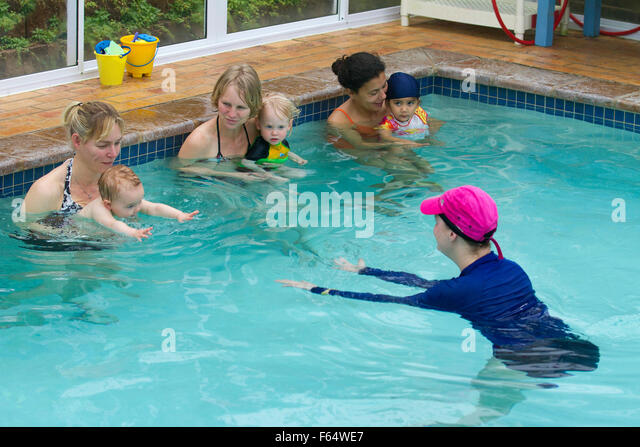 Swimming lessons stock photos swimming lessons stock images alamy 3 month old baby swimming pool