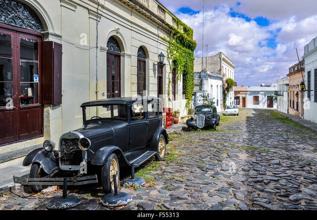 Old black automobile on the street of Colonia del Sacramento, a colonial city in Uruguay. - Stock Image